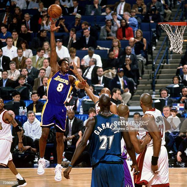 Kobe Bryant of the Western Conference AllStars attempts a shot against Grant Hill of the Eastern Conference AllStars during the 2000 NBA AllStar Game...