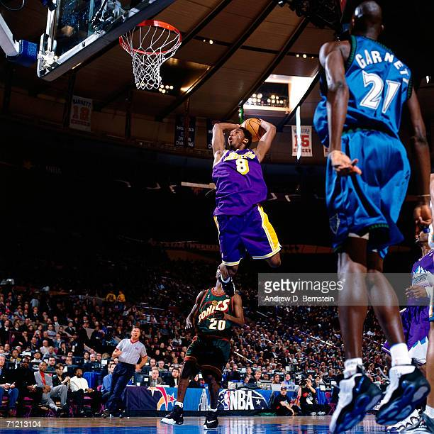 Kobe Bryant of the Western Conference All-Stars drives to the basket for a dunk against the Eastern Conference during the 1998 NBA All-Star game on...