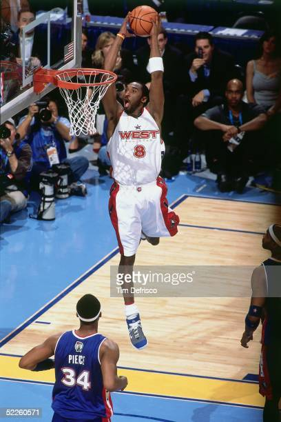 Kobe Bryant of the Western Conference AllStars dunks against Paul Pierce of the Eastern Conference AllStars during the 2005 NBA AllStar Game at The...