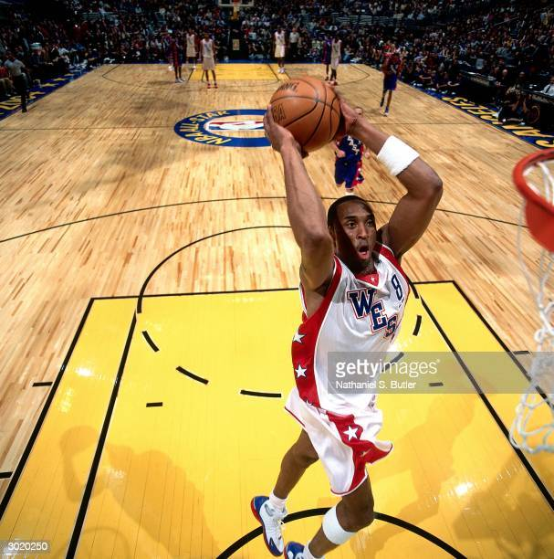 Kobe Bryant of the Western Conference AllStars dunks against the Eastern Conference AllStars during the 2004 AllStar Game on February 15 2004 at...