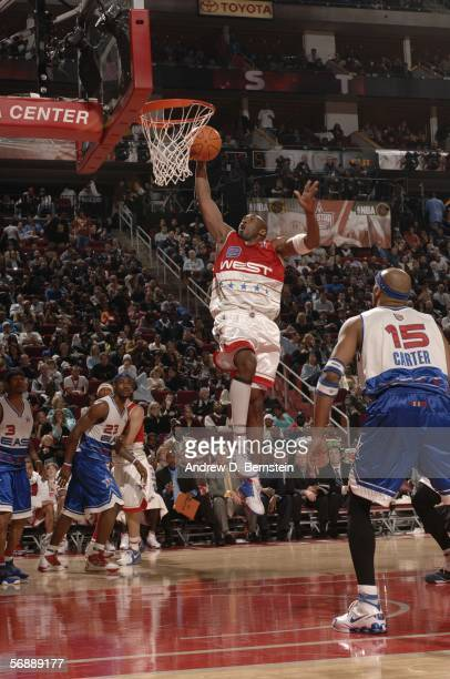 Kobe Bryant of the Western Conference AllStars dunks against the Eastern Conference AllStars during the 2006 NBA AllStar Game on February 19 2006 at...