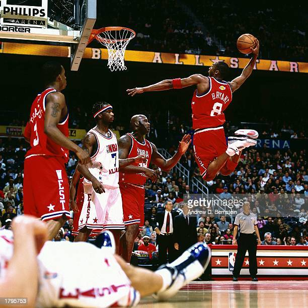 Kobe Bryant of the Western Conference All-Stars goes for a dunk against the Eastern Conference All-Stars during the 2003 NBA All-Star Game at the...