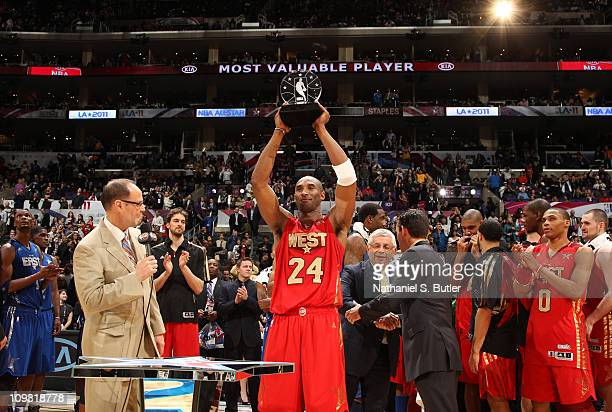 Kobe Bryant of the Western Conference AllStars holds his MVP trophy presented by KIA after the 2011 NBA AllStar Game on February 20 2011 at the...