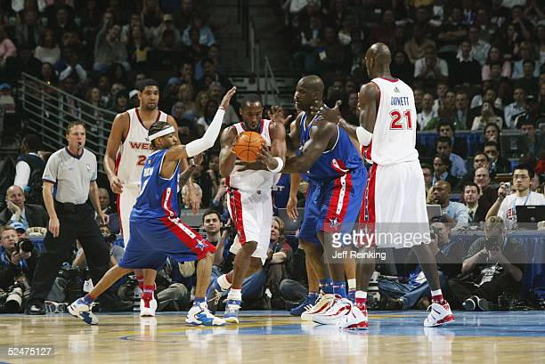 Kobe Bryant of the Western Conference AllStars moves the ball against Shaquille O'Neal of the Eastern Conference AllStars during the 54th AllStar...