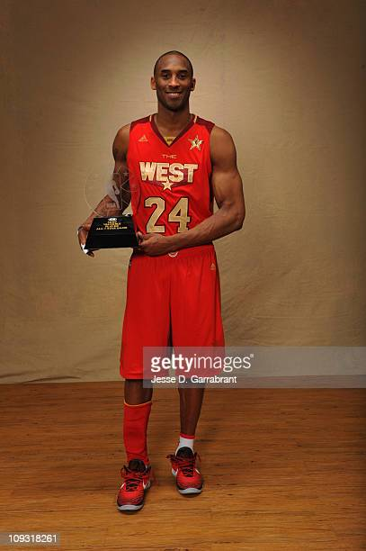 Kobe Bryant of the Western Conference AllStars poses for a portrait with the Kia MVP trophy after the 2011 NBA AllStar Game on February 20 2011 at...