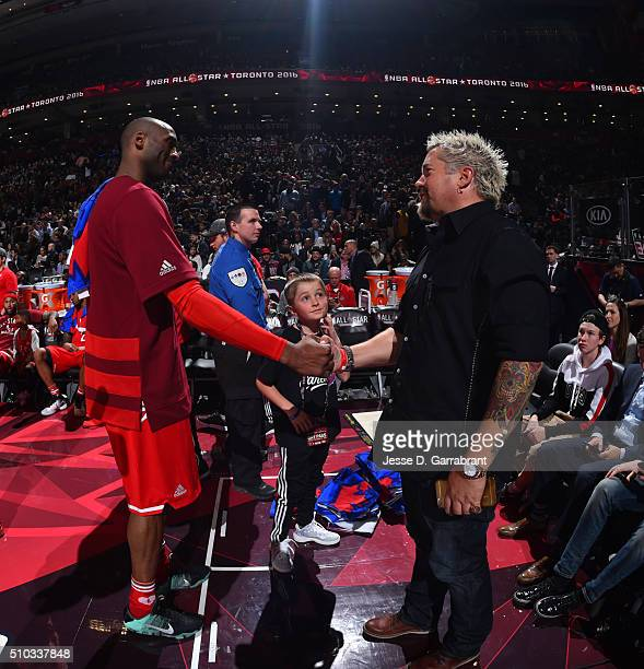 Kobe Bryant of the Western Conference All-Stars shakes hand with famous chef Guy Fieri during the NBA All-Star Game as part of the 2016 NBA All Star...