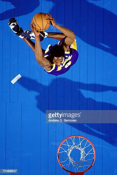 Kobe Bryant of the Western Conference AllStars soars for a dunk against the Eastern Conference AllStars during the 1998 NBA AllStar game played...