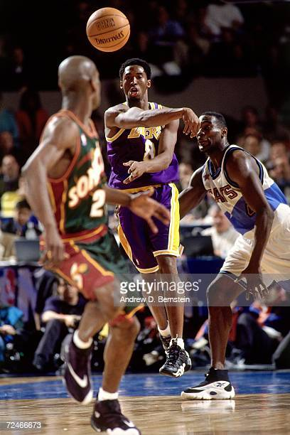 Kobe Bryant of the Western Conference All-Stars throws a pass up court to teammate Gary Payton against the Eastern Conference All-Stars during the...
