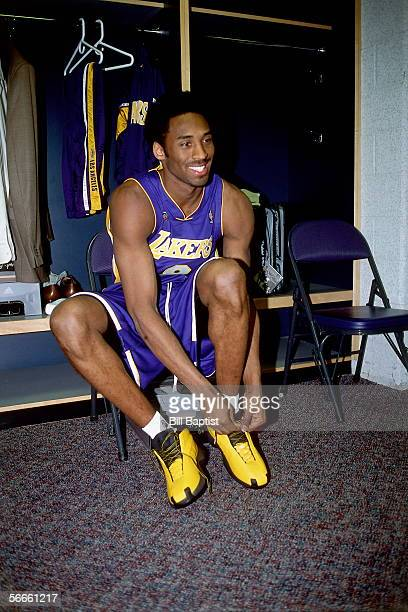 Kobe Bryant of the Western Conference AllStars ties his sneaker in the locker room prior to the 2002 NBA AllStar Game on February 10 2002 at the...