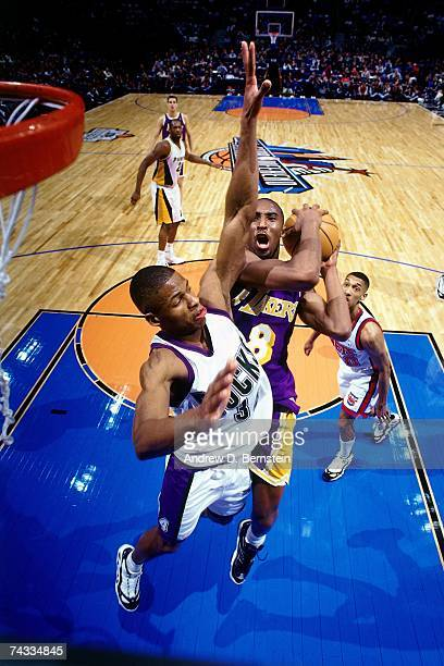 Kobe Bryant of the Western Conference attempts a layup against Ray Allen of the Eastern Conference during the 1997 Rookie Game played February 8 1997...