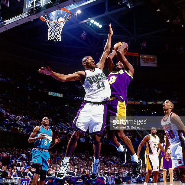 Kobe Bryant of the Western Conference attempts a layup against Ray Allen of the Eastern Conference during the 1997 Rookie AllStar game played...