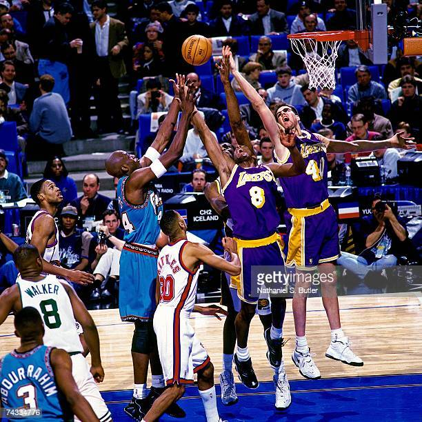 Kobe Bryant of the Western Conference battles for a rebound against the Eastern Conference during the 1997 Rookie AllStar game played February 8 1997...