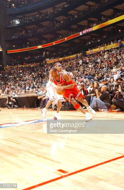 Kobe Bryant of the Western Conference dribbles around Allen Iverson of the Eastern Conference during the 2003 NBA AllStar game on February 9 2003 at...