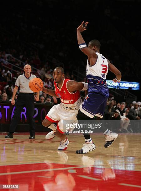 Kobe Bryant of the Western Conference drives against Dwyane Wade of the Eastern Conference during the 2006 NBA AllStar Game February 19 2006 at the...