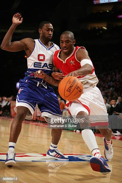 Kobe Bryant of the Western Conference drives against Gilbert Arenas of the Eastern Conference during the 2006 NBA AllStar Game February 19 2006 at...