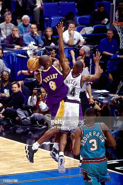 Kobe Bryant of the Western Conference drives to the basket against Ray Allen of the Eastern Conference during the 1997 Rookie Game played February 8...