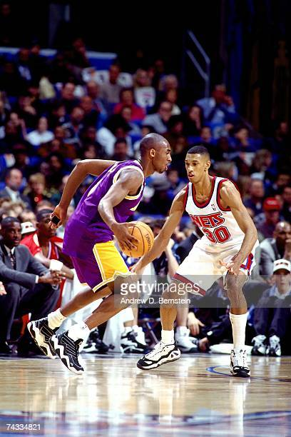 Kobe Bryant of the Western Conference drives to the basket against Kerry Kittles of the Eastern Conference during the 1997 Rookie Game played...