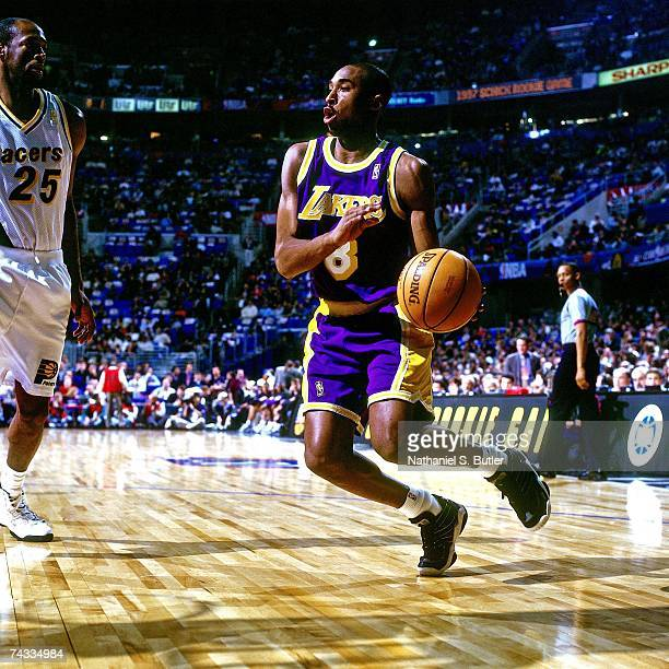 Kobe Bryant of the Western Conference drives to the basket against the Eastern Conference during the 1997 Rookie AllStar game played February 8 1997...