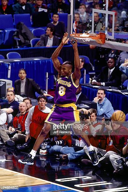 Kobe Bryant of the Western Conference finishes a dunk against the Western Conference during the 1997 Rookie Game played February 8 1997 at the Gund...