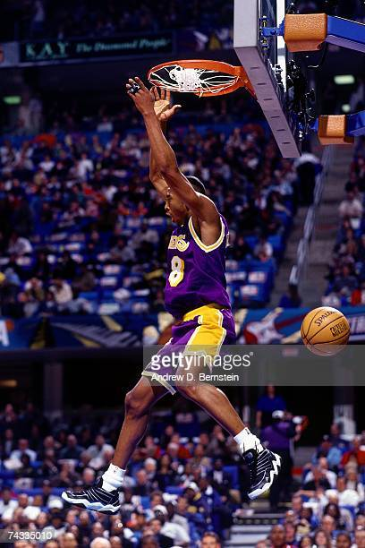 Kobe Bryant of the Western Conference finishes a dunk against the Eastern Conference during the 1997 Rookie Game played February 8 1997 at the Gund...