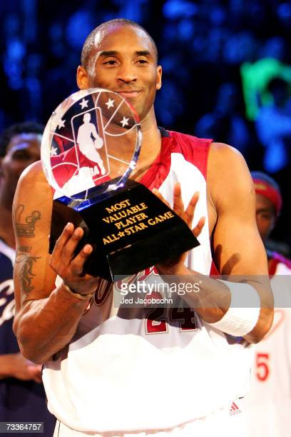 Kobe Bryant of the Western Conference holds the MVP trophy after defeating the Eastern Conference 153 - 132 in the 2007 NBA All-Star Game on February...