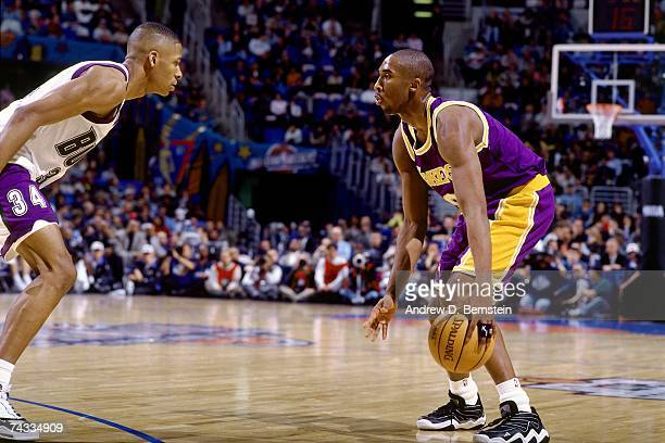 Kobe Bryant of the Western Conference looks to get to the basket against Ray Allen of the Eastern Conference during the 1997 Rookie Game played...