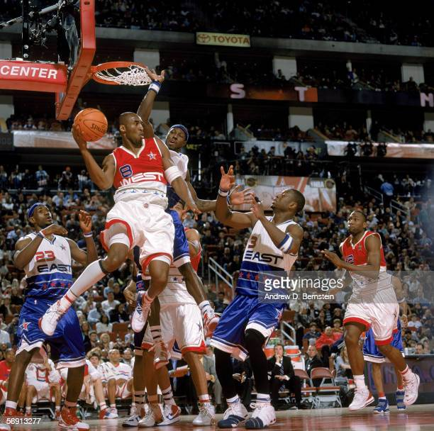 Kobe Bryant of the Western Conference looks to pass against Ben Wallace and Dwyane Wade of the Eastern Conference during the 2006 NBA AllStar Game at...