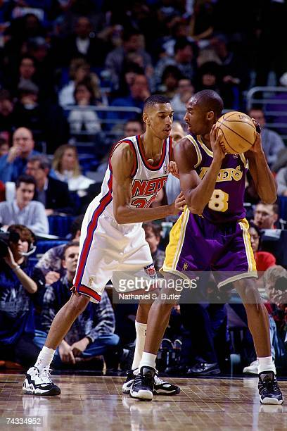 Kobe Bryant of the Western Conference posts up against Kerry Kittles of the Eastern Conference during the 1997 Rookie Game played February 8 1997 at...