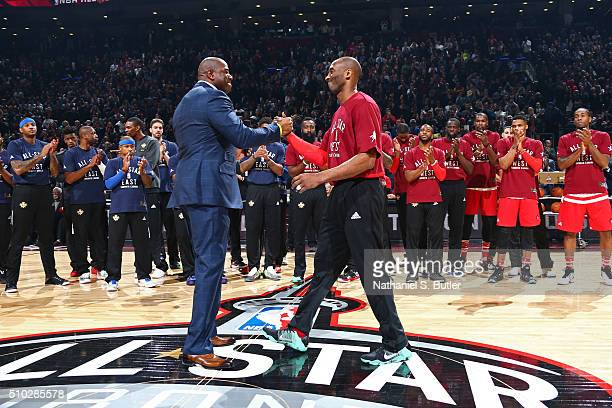 Kobe Bryant of the Western Conference shakes the hand of NBA Legend Magic Johnson before the NBA AllStar Game as part of 2016 NBA AllStar Weekend on...