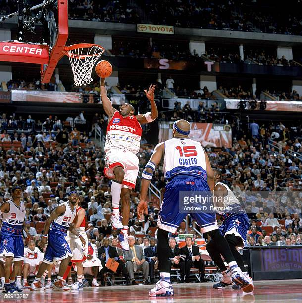 Kobe Bryant of the Western Conference takes the ball to the basket during the 2006 NBA AllStar Game against the Eastern Conference at Toyota Center...