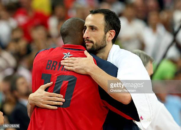 Kobe Bryant of United States and Manu Ginobili of Argentina hug after the United States defeats Argentina 10983 during the Men's Basketball semifinal...