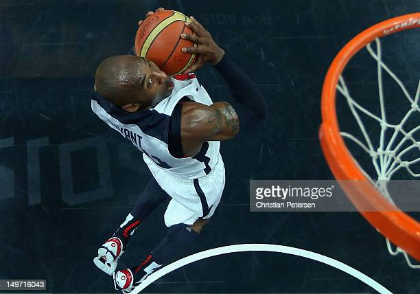 Kobe Bryant of United States goes up for a slam dunk against Nigeria in the first half during the Men's Basketball Preliminary Round match on Day 6...