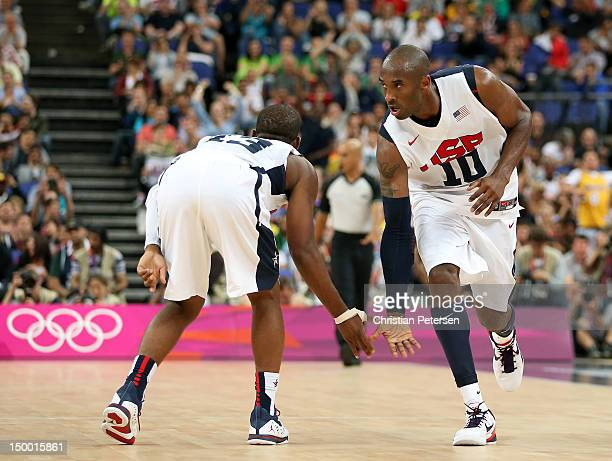 Kobe Bryant of United States reacts with teammate Chris Paul after Bryant makes a three-pointer in the second half against Australia during the Men's...