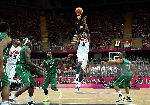 Kobe Bryant of United States shoots Chamberlain Oguchi of Nigeria in the first half during the Men's Basketball Preliminary Round match on Day 6 of...