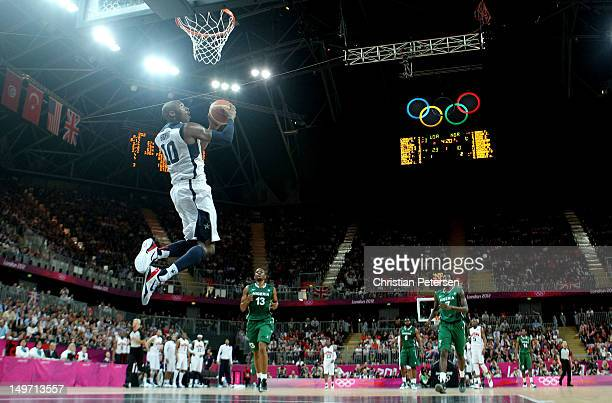 Kobe Bryant of United States slam dunks against Nigeria in the first half during the Men's Basketball Preliminary Round match on Day 6 of the London...