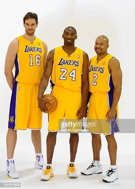 Kobe Bryant Pau Gasol and Derek Fisher of the Los Angeles Lakers pose for a photograph during Media Day at the Toyota Center on September 25 2010 in...
