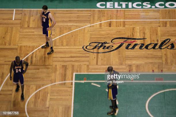 Kobe Bryant Pau Gasol and Lamar Odom of the Los Angeles Lakers stand on the court dejected late in the fourth quarter against the Boston Celltics...