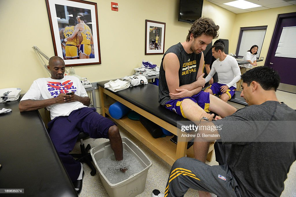 Kobe Bryant #24, Pau Gasol #16, and Steve Nash #10 of the Los Angeles Lakers sit in the training room before facing the Utah Jazz at Staples Center on October 22, 2013 in Los Angeles, California.