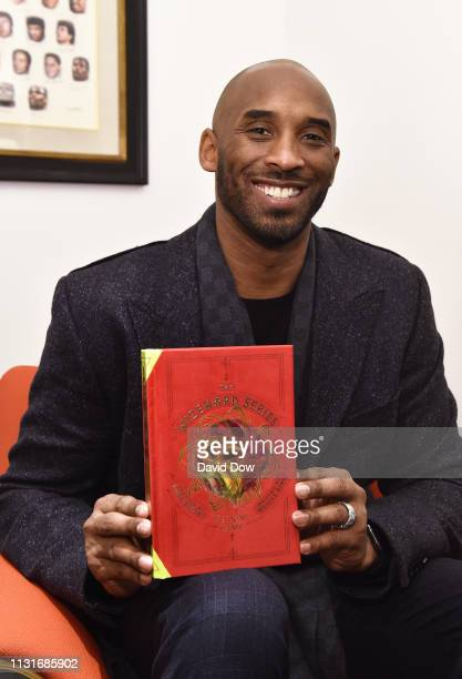 Kobe Bryant poses for a photo during the launch Granity Studios' debut book The Wizenard Series Training Camp to young athletes at the flagship NBA...