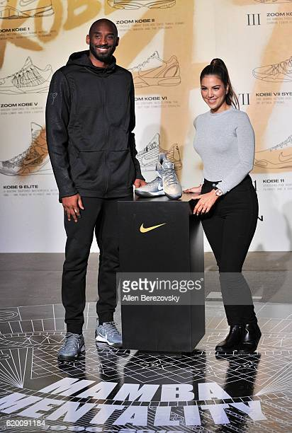 Kobe Bryant poses for a picture with Liz Hernandez during a Kobe AD event at MAMA Gallery on November 1 2016 in Los Angeles California