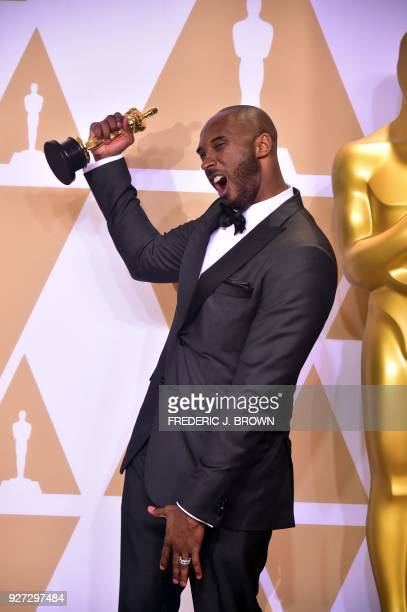 Kobe Bryant poses in the press room with the Oscar for Best Animated Short Film for Dear Basketball during the 90th Annual Academy Awards on March 4...