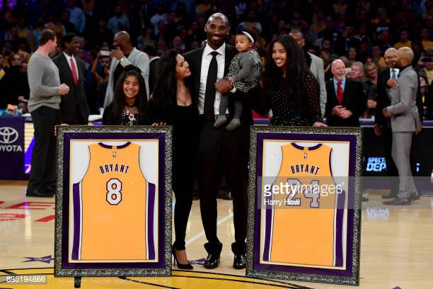Kobe Bryant poses with his family at halftime after both his and Los Angeles Lakers jerseys are retired at Staples Center on December 18 2017 in Los...