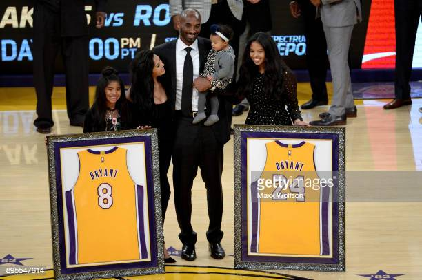 Kobe Bryant poses with his family at halftime after both his and Los Angeles Lakers jerseys are retired at Staples Center on December 18, 2017 in Los...