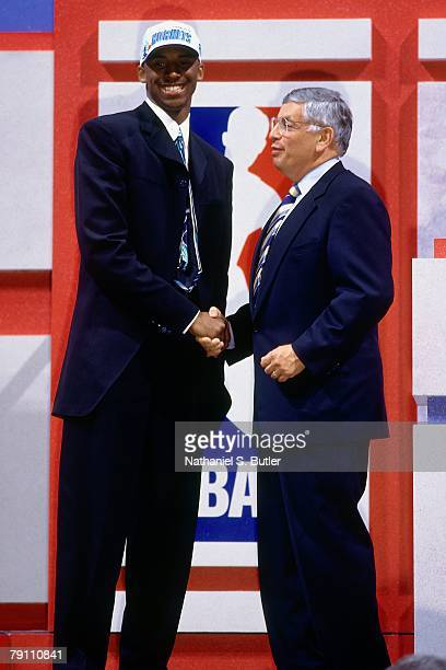 Kobe Bryant poses with NBA Commissioner David Stern after being selected in the first round of the 1996 NBA Draft on June 26 1996 at Madison Square...