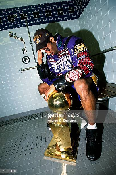 Kobe Bryant poses with the NBA Championship trophy after defeating the Philadelphia 76ers in game five of the 2001 NBA Finals played June 15 2001 at...