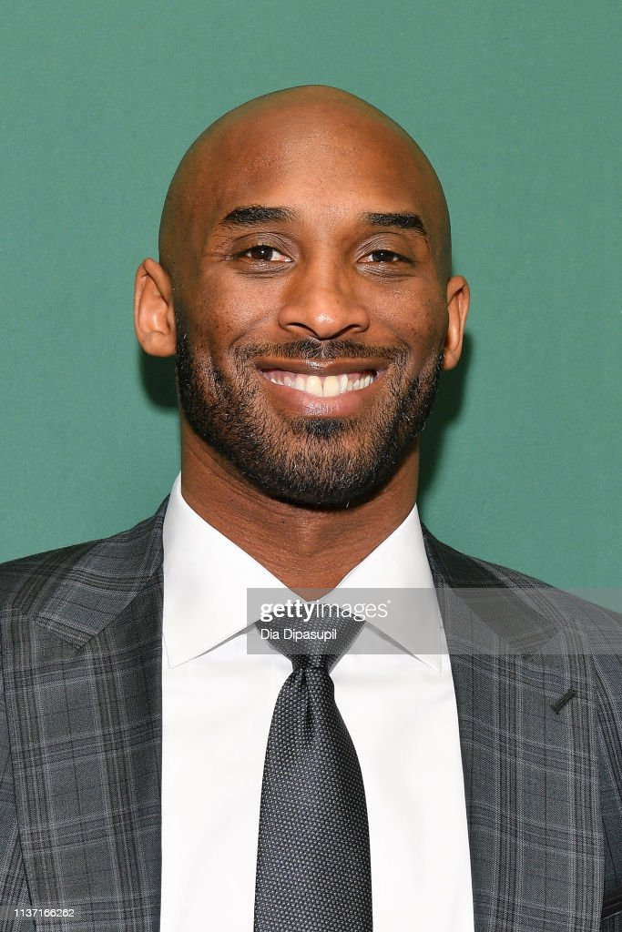 "NY: Kobe Bryant Signs Copies Of His Book ""Training Camp (The Wizenard Series #1)"""
