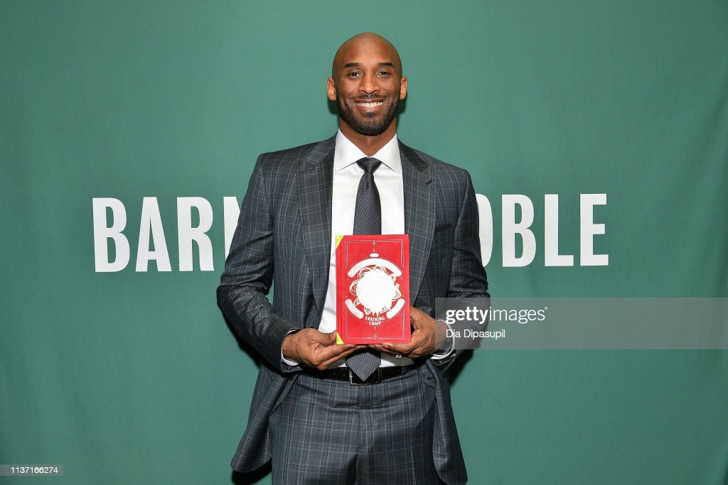 """NY: Kobe Bryant Signs Copies Of His Book """"Training Camp (The Wizenard Series #1)"""""""
