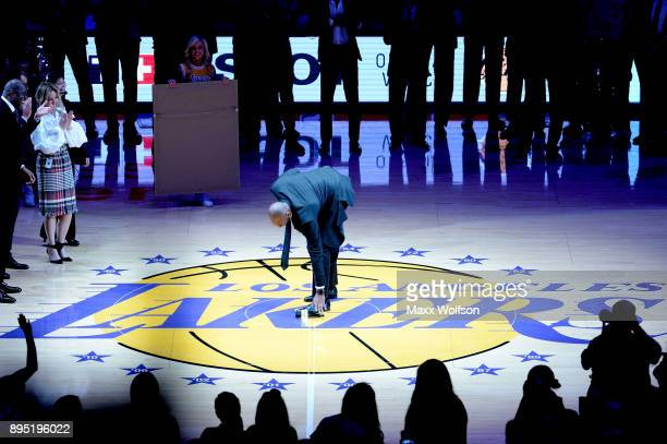 Kobe Bryant puts down the microphone after he addresses the crowd at halftime as both his and Los Angeles Lakers jerseys are retired at Staples...