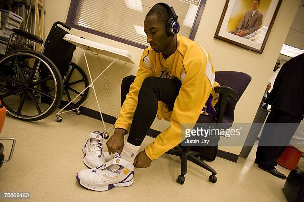 Kobe Bryant puts on his shoes before Lakers game at the Staples Center, Los Angeles, California.