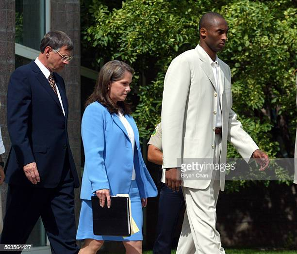 Kobe Bryant right leaves Eagle County Justice Center with his defense attorneys Harold Haddon and Pamela Mackey after his first court appearance in...